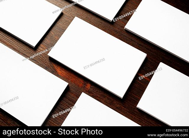 Blank business cards mock-up on wooden background. Copy space for text