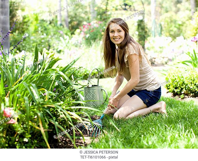 Portrait of young woman in garden