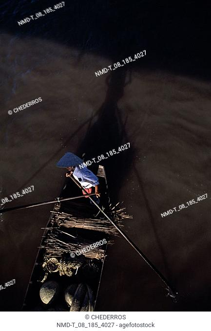 High angle view of a person rowing a boat, Vietnam