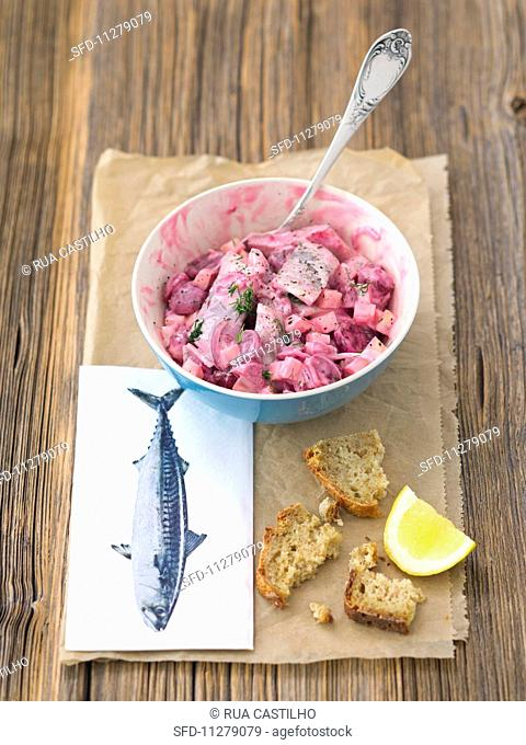 Herring salad with beetroot, onions apple and mayonnaise