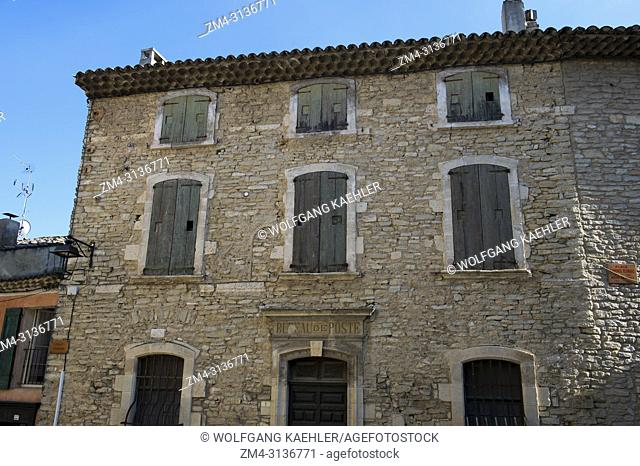 A village scene with detail of the old post office in the medieval village of Goult in the Luberon, Provence-Alpes-Cote d Azur region in southern France