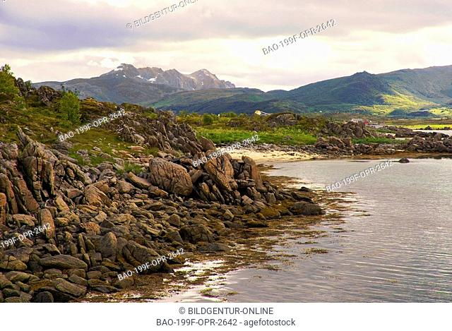 This image shows a beautiful Spring landscape of a coastline at the Lofoten Island of Vestvagoy that belong to Norway. The shoreline itself consists of large...