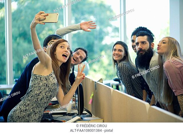 Young adult friends taking group selfie
