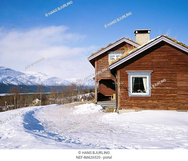 Wooden country house in winter landscape