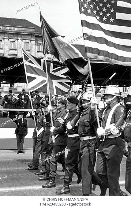 A flag group with the flags of the allied forces walking past a VIP stand during the final rehearsal for the parade on occasion of the 'Armed Forces Day' on...