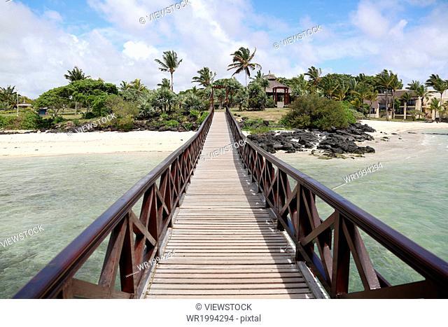 Wooden bridge over sea