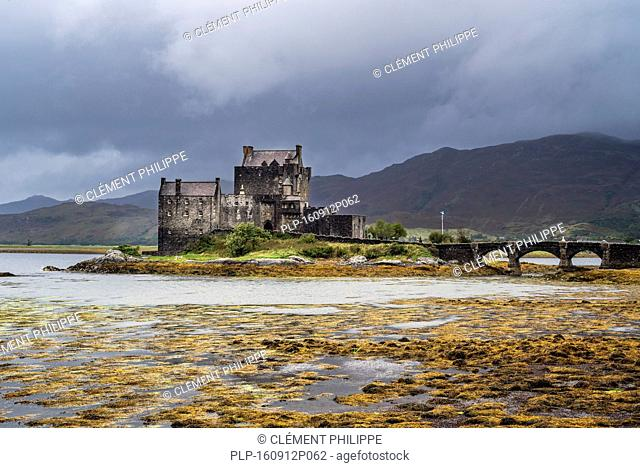 Eilean Donan Castle in Loch Duich during rain shower, Ross and Cromarty, Western Highlands of Scotland, UK