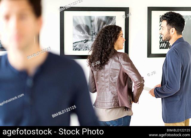 Couple admiring art in gallery