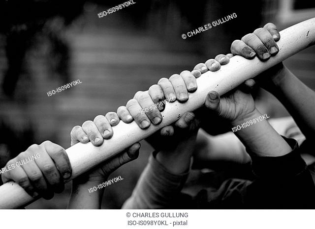 Children holding on to railing