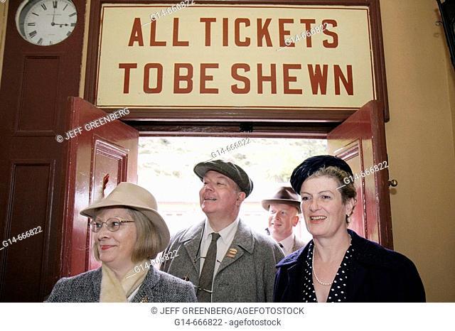 UK, England, North Yorkshire, Goathland, North Yorkshire Moors Railway, station, 1940's Weekend, passengers, World War II period clothing