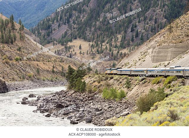 Passenger train travelling in the North Thompson River Canyon in British Columbia, Canada