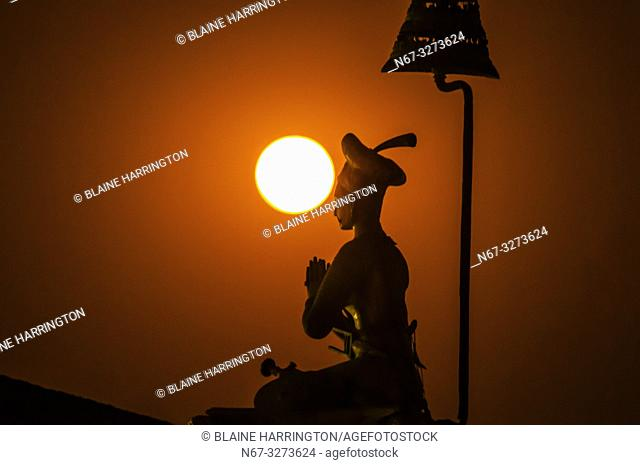 The statue of King Bhupatindra Malla silhouetted by a full moon, Durbar Square, Bhaktapur, Kathmandu Valley, Nepal
