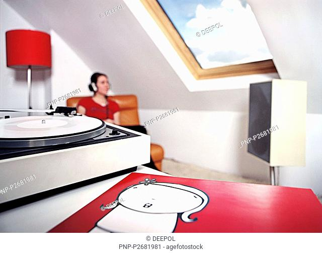 Woman listens to record