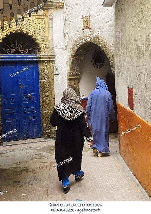women in a doorway, Medina, Essaouira, Morocco