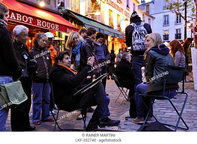 Street artist with tourists in the evening, Montmartre, Paris, France, Europe