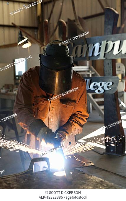 Welder And Metal Work Artist Doug Schwiesow Working On A Custom Sign Designed With A Local Artist For The Kenai Peninsula College Kachemak Bay Campus