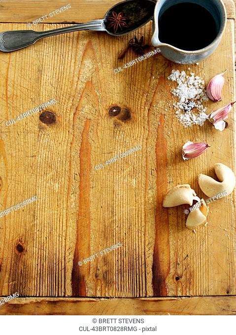 Garlic and fortune cookies on board