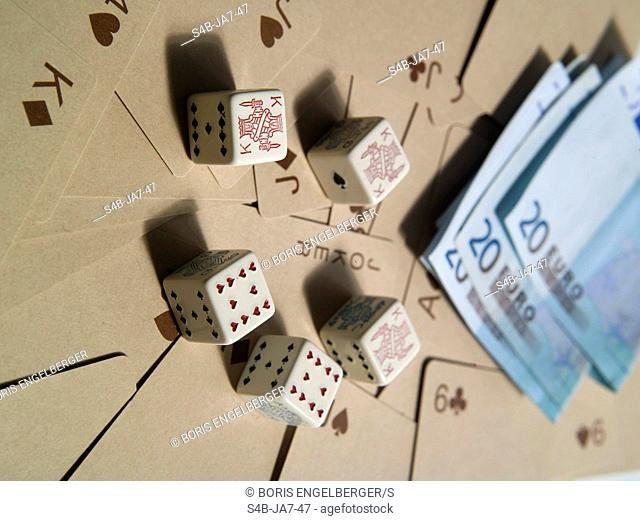 Poker dices, cards and Euro banknotes