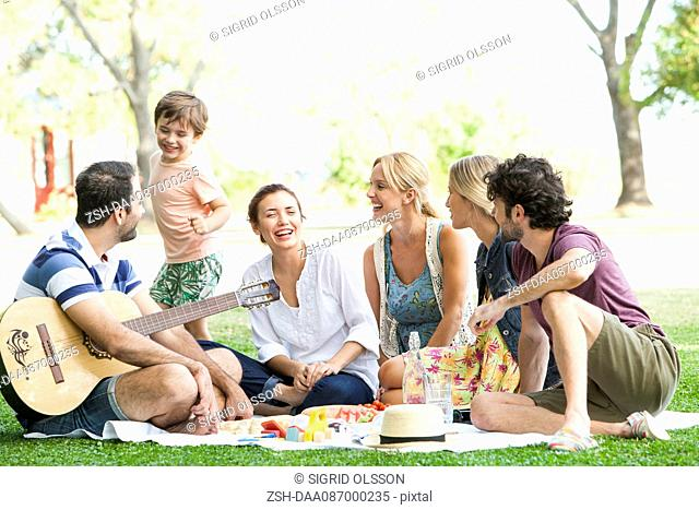 Friends enjoying picnic in park