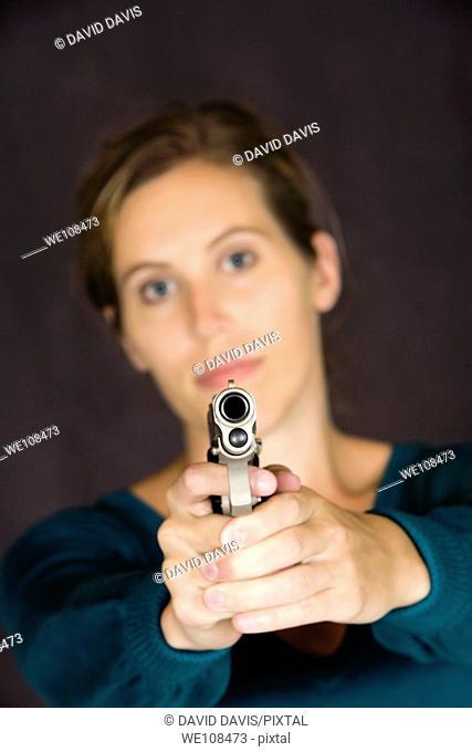 Woman defending herself with handgun