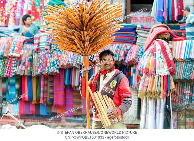 Nepal, Central Region, Kathmandu, A palm tree from flutes - A friendly street trader in the city district of Tyauda in Kathmandu