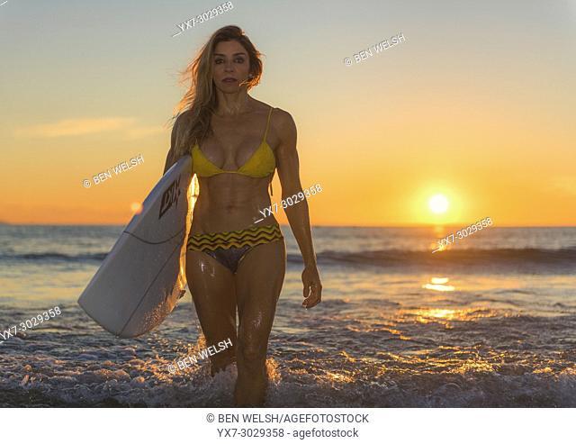 Woman in bikini at the beach at sunset. Tarifa, Cadiz, Costa de la Luz, Andalusia, Spain