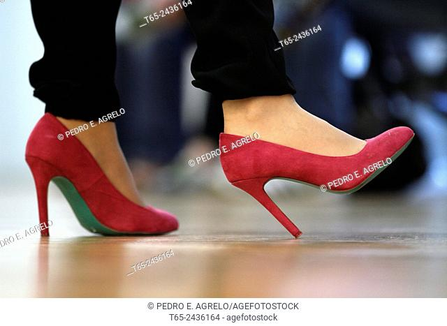 A woman with red heels shoes