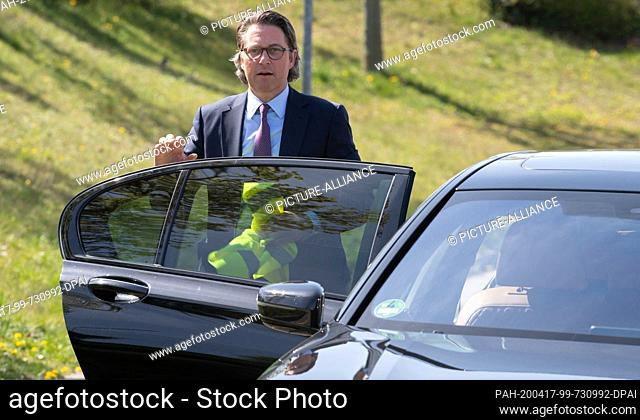 16 April 2020, Brandenburg, Großbeeren: Federal Minister of Transport Andreas Scheuer (CSU) climbs up the stairs before visiting the logistics service provider...