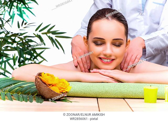 Woman during massage session in spa salon