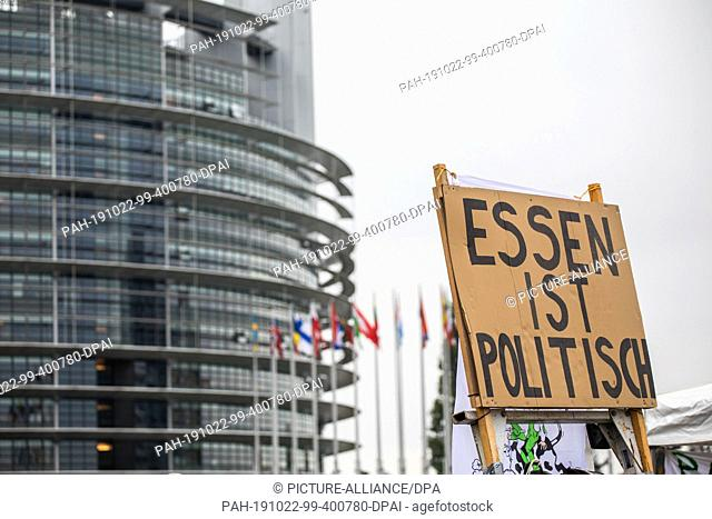 """22 October 2019, France (France), Straßburg: A poster with the inscription """"""""Essen ist Politisch"""""""" (Essen is Political) stands in front of the European..."""
