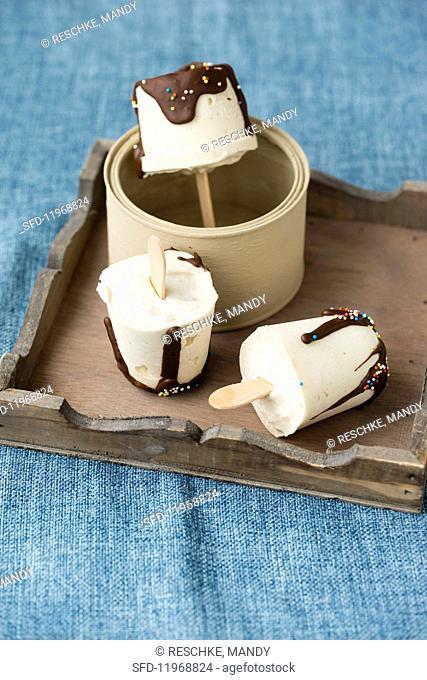 Homemade vanilla ice cream sticks with chocolate glaze