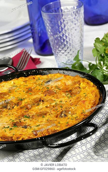 Rice with egg crust served in paella