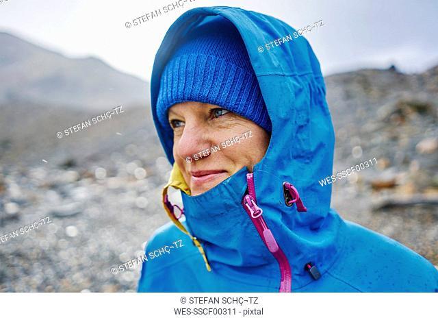 Argentina, Patagonia, El Chalten, portrait of woman in raincoat at Cerro Torre in Los Glaciares National park