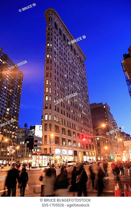 The night view of Flatiron Building with Fifth Avenue in foreground  New York City  New York  USA