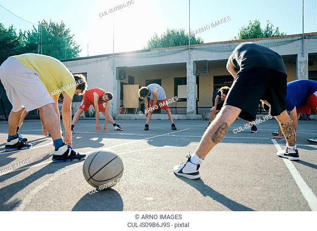 Friends on basketball court warming up