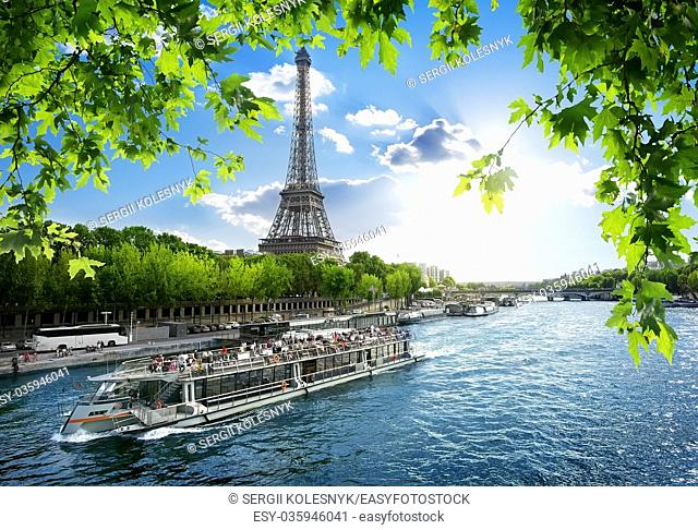 Boat trip on Seine with the view on Eiffel Tower in Paris, France