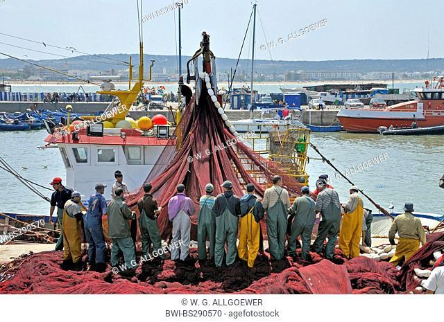 fishermen unraveling a fishing net, Morocco, Essaouira