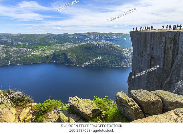 View to the Lysefjorden, tourists on the rock Preikestolen, near Forsand in Norway, Scandinavia