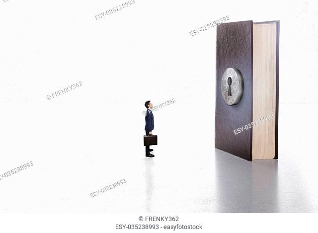 Businessman in front of a book with hole