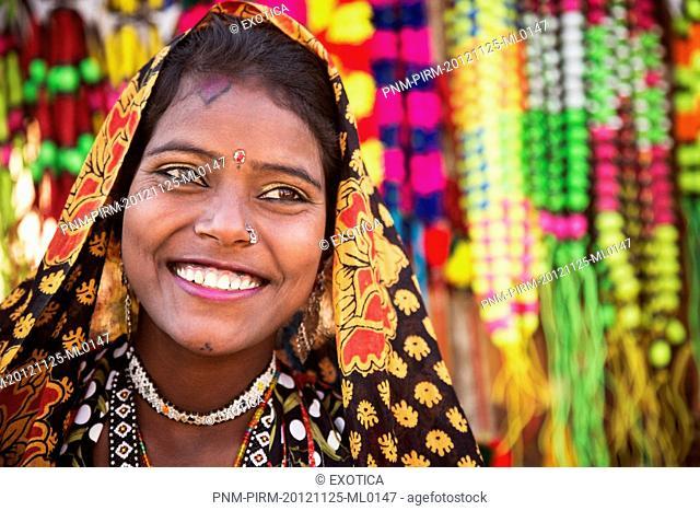 Woman posing in traditional Rajasthani dress, Pushkar, Ajmer, Rajasthan, India