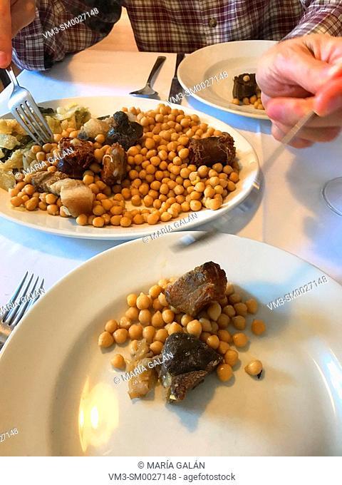 Serving cocido lebaniego in a restaurant. Cantabria, Spain