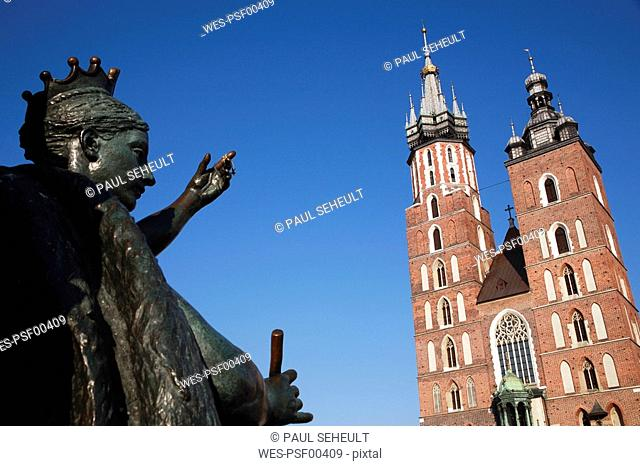 Poland, Cracow, St Marys church and sculpture in foreground