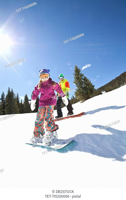 USA, Colorado, Telluride, Father and daughter 10-11 snowboarding