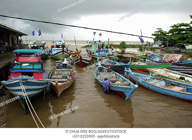 Small fishing boats berthed by the beach of Mempawah, West Kalimantan, Indonesia