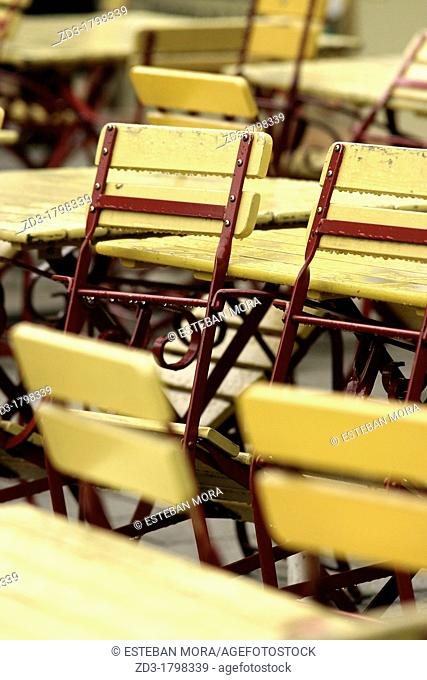 Yellow chairs in a terrace of Munich, under the rain, Bavaria, Germany