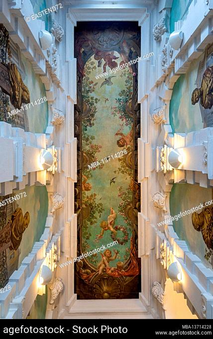 Germany, Saxony-Anhalt, Magdeburg, magnificent staircase with ceiling paintings, putti in the style of baroque quadrature painting, stucco