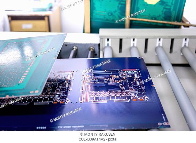 Circuit boards in processing machine in circuit board factory