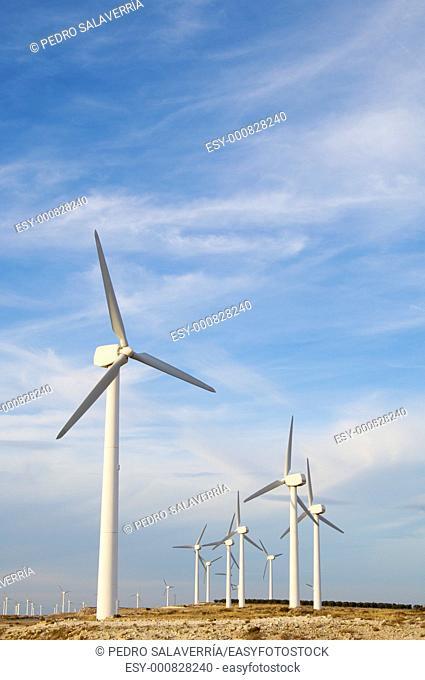 windmills group with cloudy sky in La Muela, Saragossa, Aragon, Spain