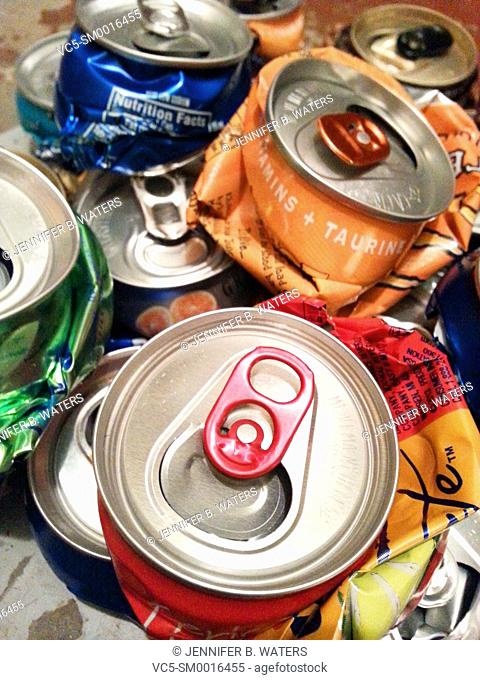 Aluminum cans that have been crushed for recycling