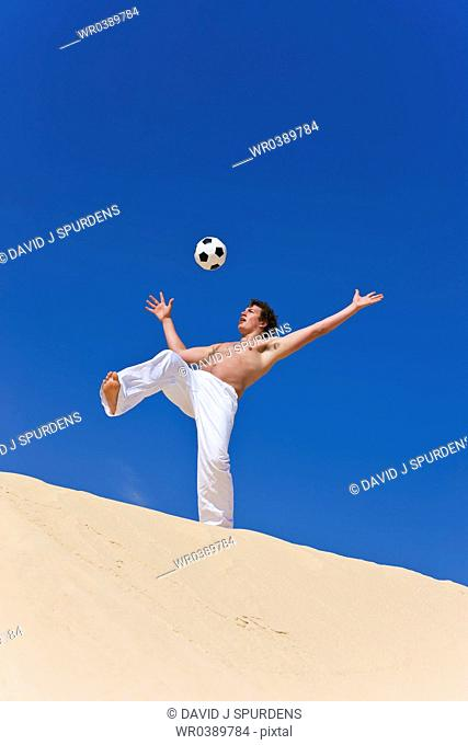 Beach Soccer player gets ready to trap the ball